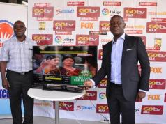 Joseph Bogera (R) GM GOtv Uganda and Robert Kabushenga (L) CEO Vision Group unveil Bukedde TV 2 on GOtv using the screen JPG