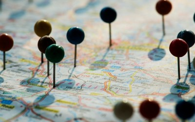 Closeup of pins on the map planning travel journey