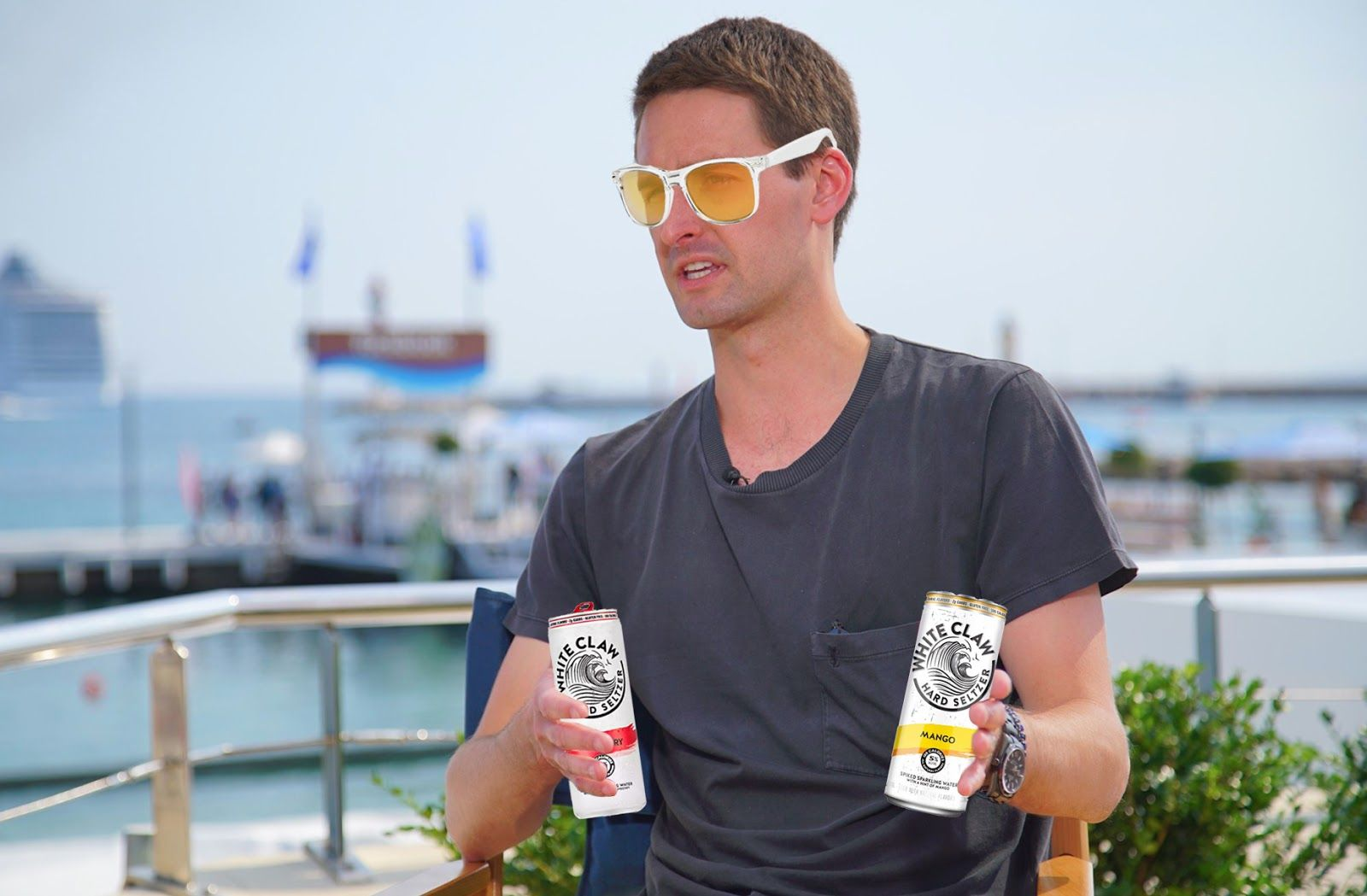 Evan Spiegel double fisting pair of White Claws that will disappear in 8 seconds