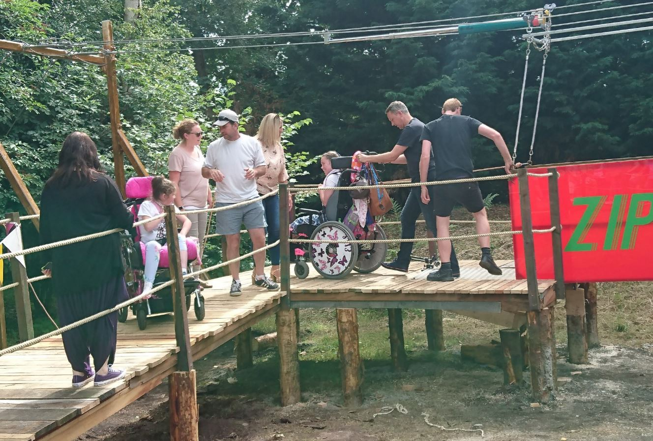 wheelchair zip wire monkey high chair with cbbc and claire house hospice