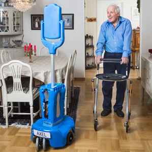 senior man using walker towards blue robot