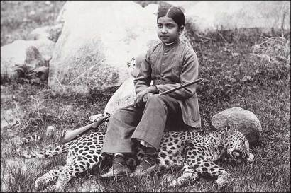 The daughter of an Indian maharajah seated on a panther she shot, sometime during 1920s.