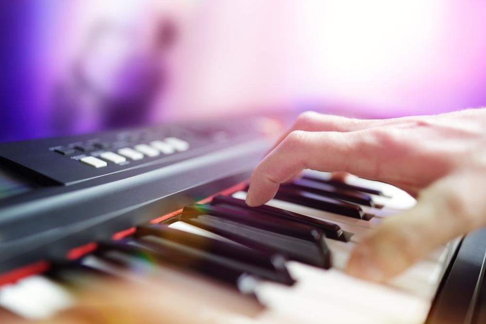 playing electronic keyboard