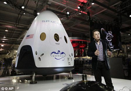 Elon Musk with his Dragon Crew capsule
