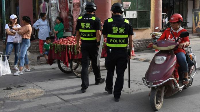 This photo, taken on 4 June 2019 ,shows police officers patrolling in Kashgar, in China's western Xinjiang region.