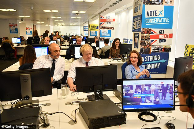 Once the person has picked up the phone, he quickly passes the headset to the Prime Minister, who grabs it from his hands