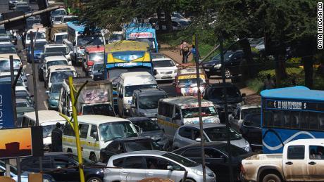 Matatus fighting through the traffic in Nairobi, Kenya.