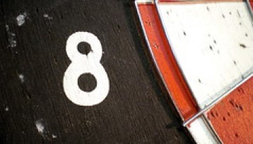 closeup of the number 8 on a dart board