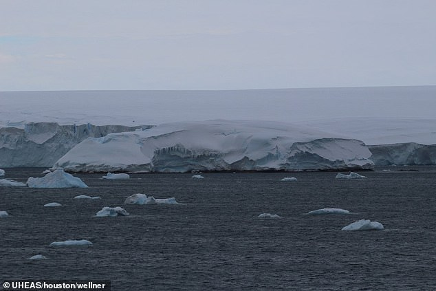 The island is big enough for satellites to spot from space but the never before seen island has previously been hidden under thick layers of ice