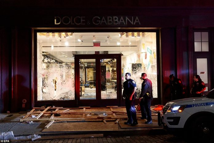 Designer destroyed: This New York Dolce and Gabbana store was completely raided and cleared of its shelves Sunday