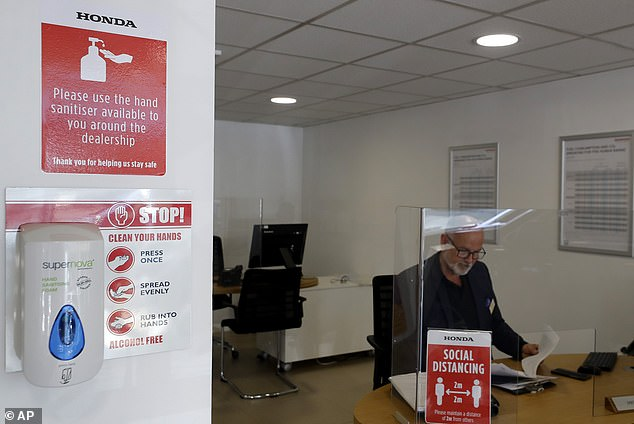 Dealers have equipped their sales stations with screens to keep the workers and customers divided