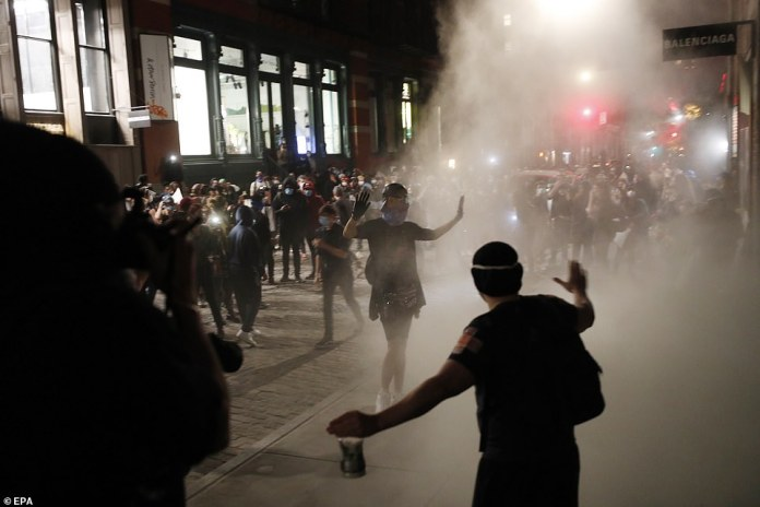 On Sunday protests decrying the police killing of black Minneapolis man George Floyd continued. Using a fire extinguisher and their bodies, a group of protesters in New York stopped looters from entering a closed business
