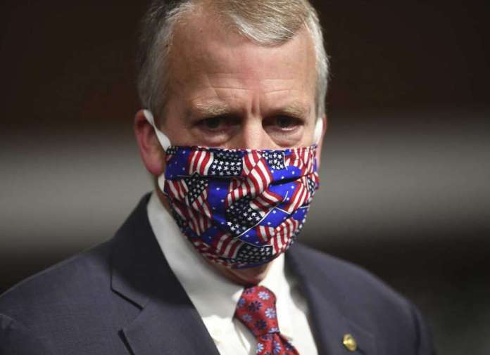 FILE - In this May 7, 2020, file photo, Sen, Dan Sullivan, R-Ark., wears a mask at a hearing in Washington. Protesters in Alaska carrying a banner and a caribou heart interrupted a campaign event for Sullivan who is seeking reelection. The Anchorage Daily News reported the small group of protesters were restrained and escorted out by staff and attendees at Sullivan's campaign launch event in a hangar near Ted Stevens Anchorage International Airport, Saturday, July 11. (Kevin Dietsch/Pool via AP, File) Photo: Kevin Dietsch, AP / UPI