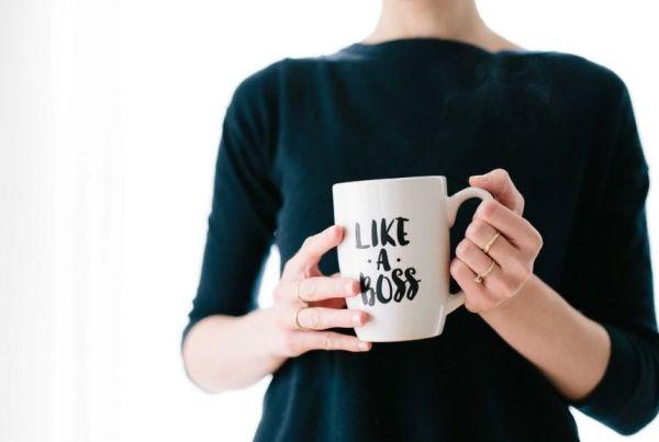 A woman with a mug that says 'Like a boss'