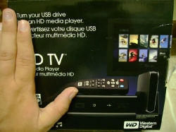 Western Digital HDTV compared to a hand
