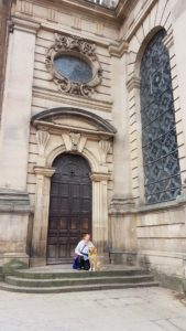 Ma & Teddy on the steps in front of the big wooden doors of the cathedral in central Birmingham