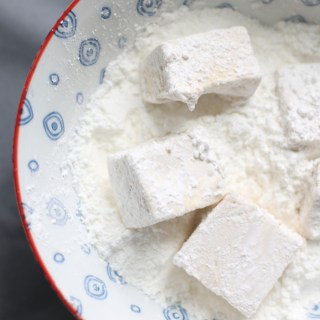 Marshmallows made from scratch, rolled in powdered sugar and cornstarch.