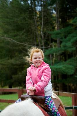 Tatum showed the same joy as her sister while riding the pony