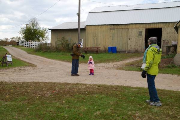 Leah directs her Grandparents towards the hayride staging area