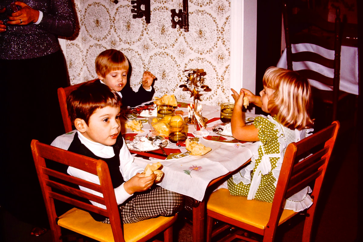 Christmas 1973: The kids table has always been a tradition at Christmas. Doug, Dickey, and Jenny with real candles