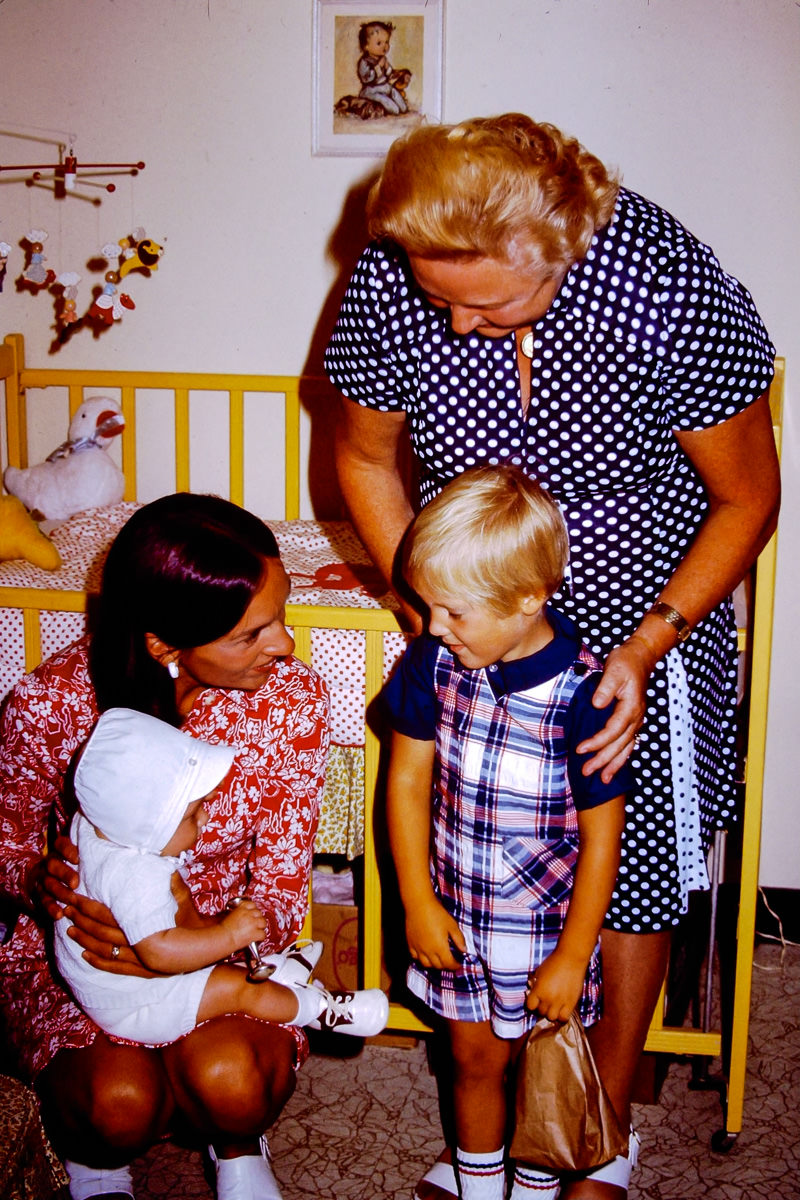 1974: My new mom Jan holds me while the agency lady tries to convince Doug he'll still be their favorite. Nice try lady!