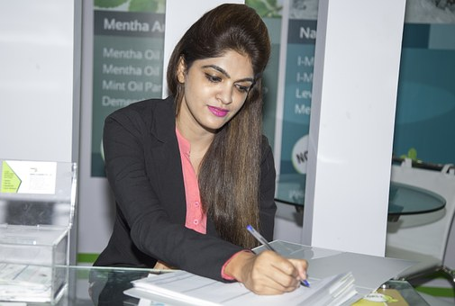 girl signing a document
