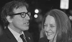 Mr. Russell shares a laugh with actress Melissa Leo on the red carpet.MIKE ELIASON/NEWS-PRESS PHOTOS