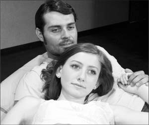 """Megan Connors, as Helen, and Trevor Thompson, as Dick Roe, star in Santa Barbara City College Theatre Arts Department's student showcase production of """"Machinal,"""" which runs for two more weeks at SBCC's Interim Theatre. RICK MOKLER PHOTO"""