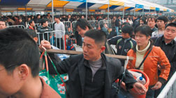 """Chinese migrant workers jam a Guangzhou train station in a scene from the documentary """"Last Train Home."""""""