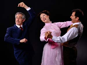 "From left, Peter S. Hadres as Colonel Pickering, Karin Hendricks as Eliza Doolittle and Andrew Philpot as Henry Higgins enjoying a dance in the PCPA production of ""My Fair Lady."" Luis Escobar Reflections Photography Studio"