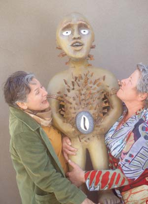 """Docents from the Detroit Institute of Arts claim ownership of a Nkisi. """"In the Forest of Detroit"""" stars Leslie Gangl Howe, left, and Lisa Gates. Courtesy photo"""