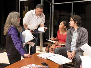 From left, director Risa Brainin and playwright Yussef El Guindi work with actors Emily Newsome, who plays the older Cindy and Roberto Tolentino, who plays the 30-year-old Omar. David Bazemore