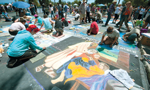 Chalk artists are hard at work Saturday in the I Madonnari Italian Street Painting Festival at the Santa Barbara Mission. The festival continues through Monday. KENNETH SONG/NEWS-PRESS PHOTO