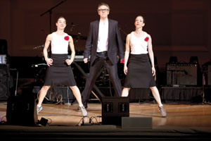 "Ira Glass, the host of the popular NPR show ""This American Life,"" returns to Santa Barbara accompanied by pair of dancers on stage as he tells his stories Evan Agostini photo"