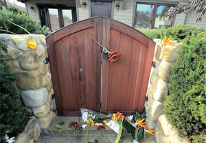 Well wishers left tokens of support to the family of actor Paul Walker at his home on Monday morning. STEVE MALONE / NEWS-PRESS