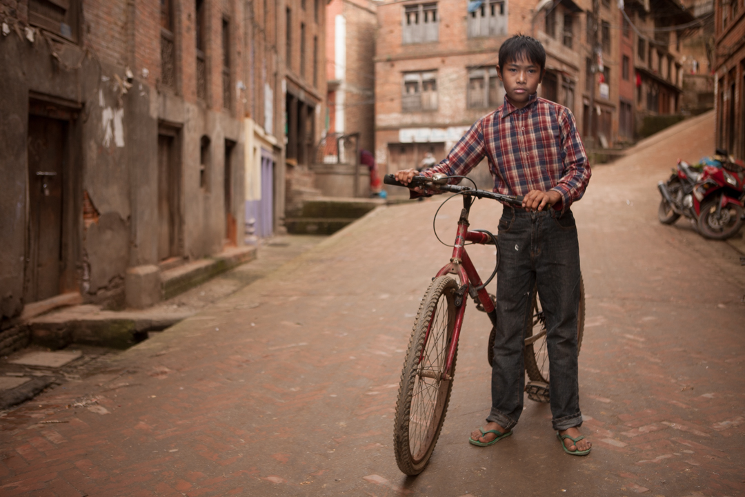 Boy with Bicycle, Bkaktapur, Nepal
