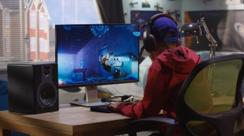 teenager playing video games