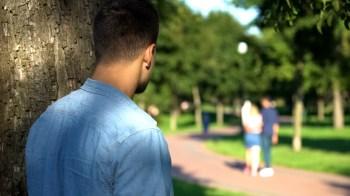 man stalking a couple