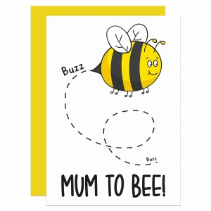 """White greetings card with bee illustration and the phrase """"Mum To Bee"""" on the front."""