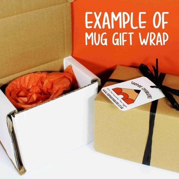 mug wrapped up in orange tissue paper with gift tag