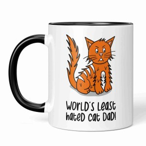 """Modern, Fun, Cartoon, Illustration, Contemporary, Funny, Humour, Colourful, Bright, Loud, Cute, Cheeky Alt Text: Black and white mug with ginger cat illustration and the phrase """"World's least hated cat Dad"""" on the front."""