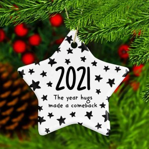 """Star shaped ceramic bauble with the phrase """"2021 The Year Hugs Made a Comeback"""""""