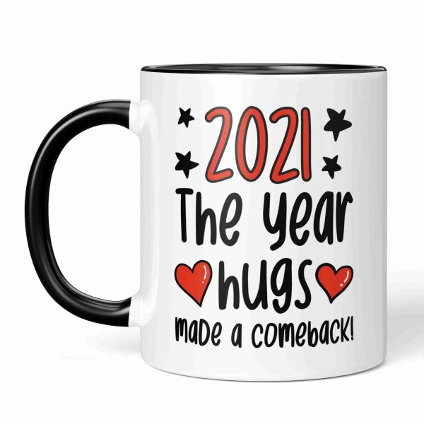 """Black and white ceramic mug with the phrase """"2021 The Year Hugs Made a Comeback"""" on either side."""