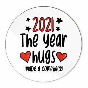 """Circle shaped coaster with the phrase """"2021 The Year Hugs Made a Comeback"""""""