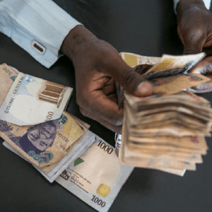 Central Bank of Nigeria Devalues Naira by 5.3% in Currency Auction – Bloomberg