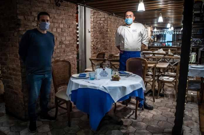 Italian restaurant and bar owners hold April 28 protest against ongoing foreclosure