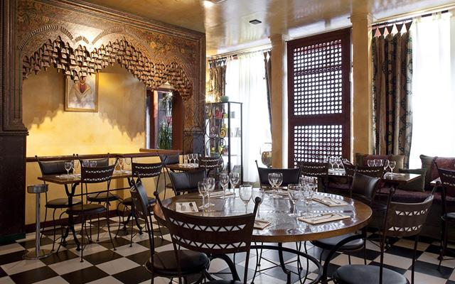 Kilims, brass trays, tiled tables and carved wooden screens set the scene for refined cooking