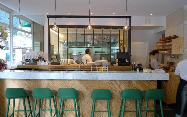 Traditional varnish has been replaced by the unfinished look of raw plywood, indicative of a casual, modern approach