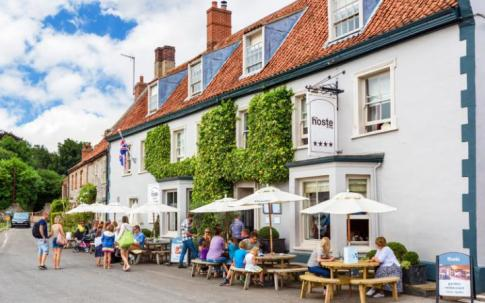 The Hoste Arms in Burnham Market serves fine ales, a lively ambiance and decent food