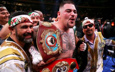 Andy Ruiz Jr (centre) celebrates the win in the WBA, IBF, WBO and IBO Heavyweight World Championships title fight at Anthony Joshua at Madison Square Garden, New York. PRESS ASSOCIATION Photo. Picture date: Saturday June 1, 2019. See PA story BOXING New Yor